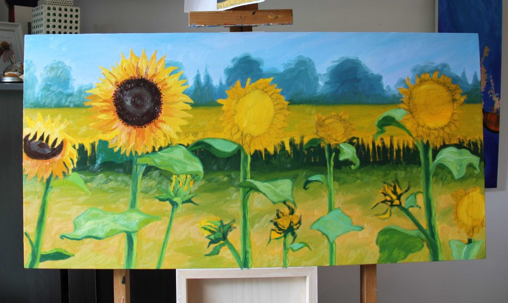 An oil painting of sunflowers in progress.